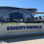 Embry-Riddle Aeronautical University campus sign in front of campus building