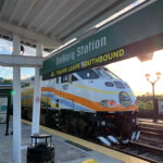 SunRail train at DeBary Station with sign that says all trains leave southbound